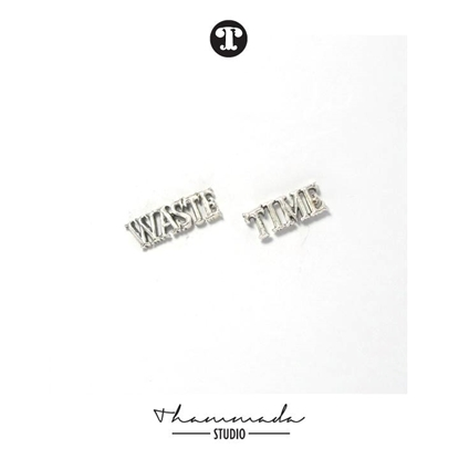 Picture of  WASTE TIME EARRING
