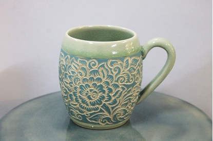 Picture of Blue flower carving mug celadon
