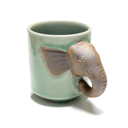 Picture of แก้วมัคสีเขียวที่จับหัวช้าง