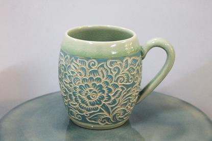 Picture of Blue flower carving mug celadon